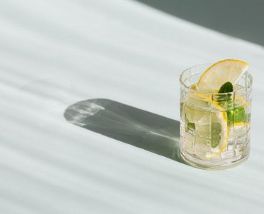 glass of cold beverage on white background